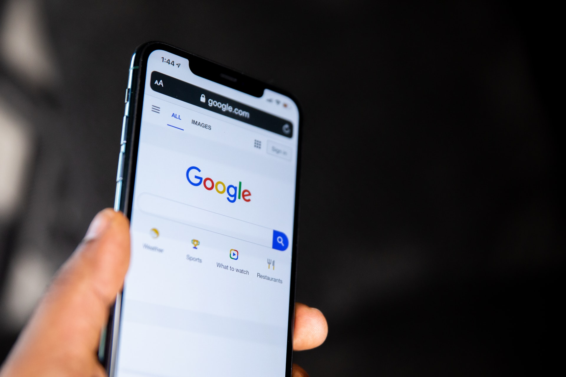 Google search bar on the screen of a smartphone