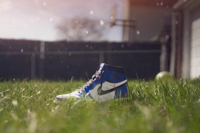 A Nike shoe on a grassy lawn
